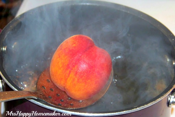 blanching peaches in a pot
