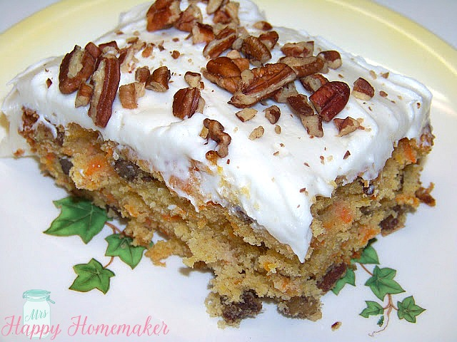 sliced carrot cake with pecans on top