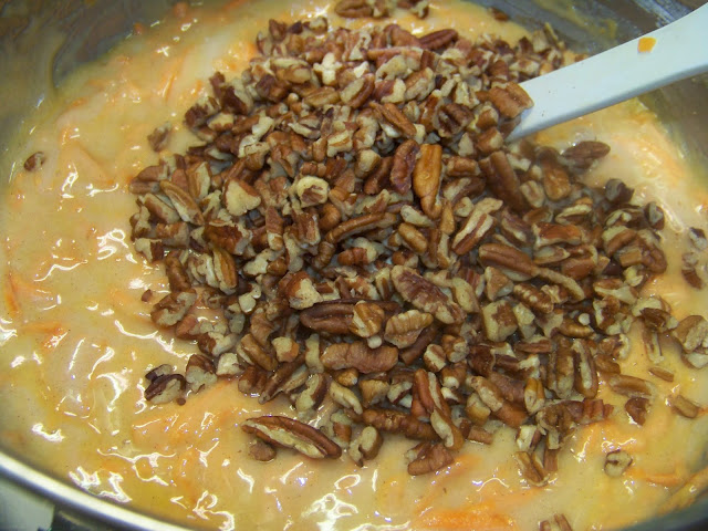 pecans being stirred into cake batter