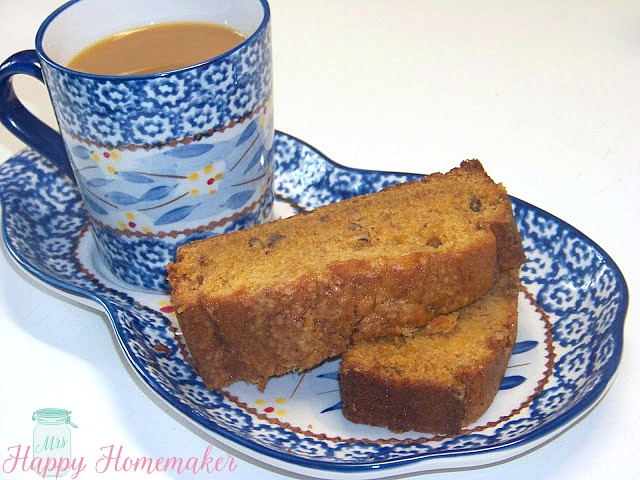 Sweet Potato Bread on a blue divided plate with a cup of coffee