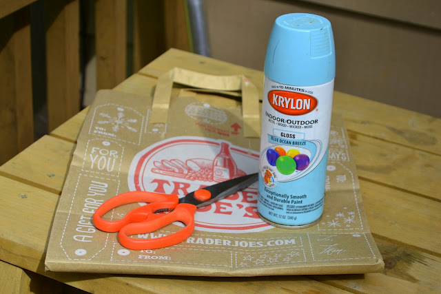 Scissors, blue spray paint, and a brown paper bag