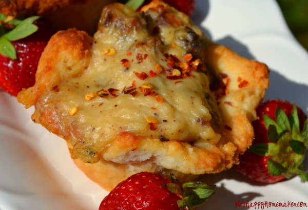 Sausage Gravy Stuffed Buttermilk Biscuits (garnished with red pepper flakes and surrounded by a couple strawberries)