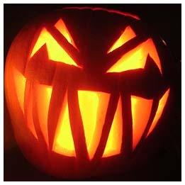 evil face carved jackolantern lit up