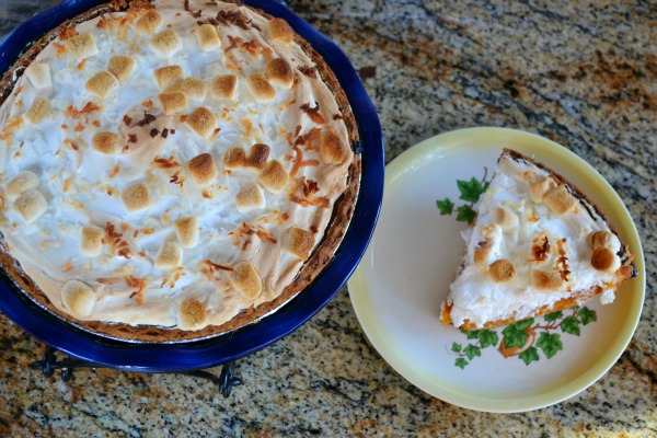 Sweet Potato Coconut Pie with Marshmallow Meringue - this recipe will take your traditional sweet potato pie to a whole new level. Everyone will rave & ask you for the recipe... and it's pretty to look at too! | MrsHappyHomemaker.com @thathousewife