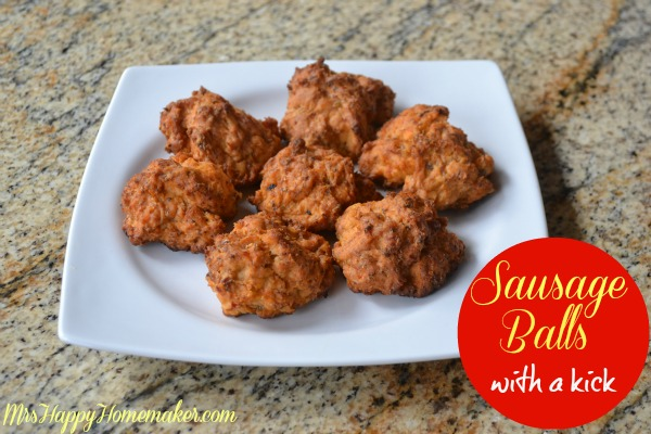 These ain't your Mama's sausage balls! With only 4 ingredients, anyone can whip these up in a jiffy. They have a slight kick to them (not too much), but you can also spice it up more by using hot sausage. A must-try recipe! | MrsHappyHomemaker.com @thathousewife