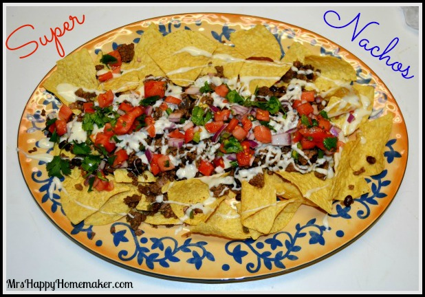 The Mrs's Super Nachos – or as my family calls them… 'The Best Nachos EVER'. Beef & black bean filling with pico de gallo & a super easy homemade cheese sauce….. so divine! You'll be super surprised by how easy these are & you'll never want 'standard' nachos ever again. Dig in! | MrsHappyHomemaker.com @thathousewife