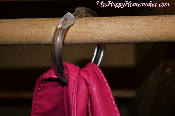 Hang your purses from shower curtain hooks