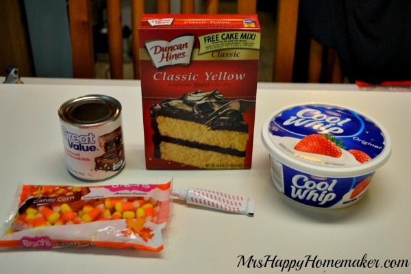 The ingredients to make Candy Corn Poke Cake on the countertop