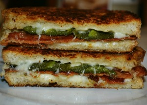 Bacon Jalapeno Grilled cheese Sandwiches cut in half and stacked up