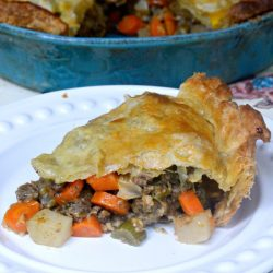 This Beef Puff Pie recipe has been a family favorite for many years now. Beef & veggies simmered in a secret ingredient then encased in a puff pastry crust. ABSOLUTELY DELICIOUS!! | MrsHappyHomemaker.com @MrsHappyHomemaker