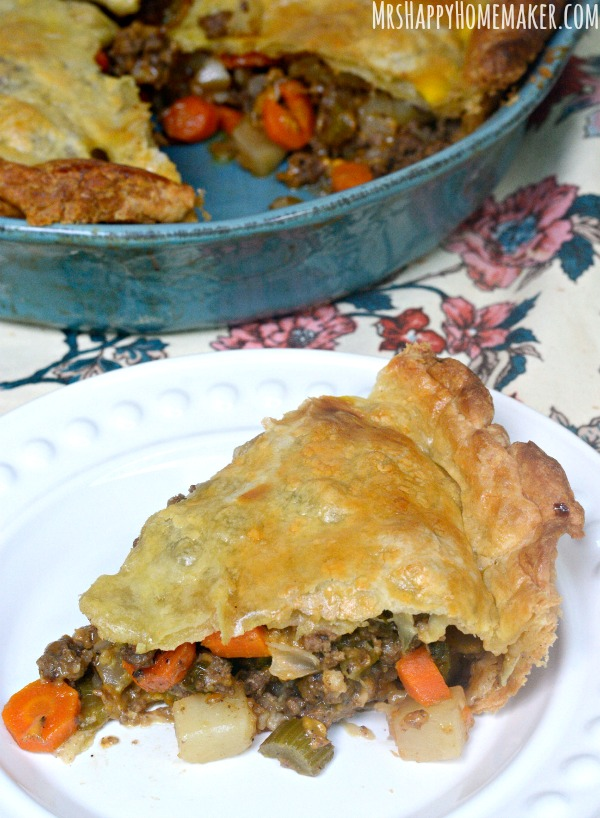 This Beef Puff Pie recipe has been a family favorite for many years now. Beef & veggies simmered in a secret ingredient then encased in a puff pastry crust. ABSOLUTELY DELICIOUS!! | MrsHappyHomemaker.com @thathousewife