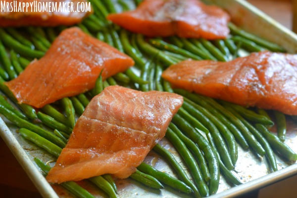 Ginger Teriyaki Salmon & Green Beans, with roasted tomatoes, lemon, garlic, & pecans, all cooked together in unity in this super simple one sheet pan meal! DELICIOUS! | Get the recipe at MrsHappyHomemaker.com