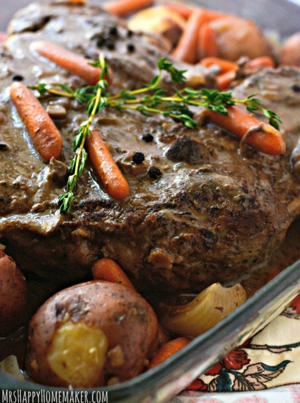 Are you looking for an absolutely delicious pot roast that requires almost no effort at all? Look no further because you've found it! My Crockpot Pot Roast is the BEST EVER, only requires 5 ingredients, & is as simple as throwing the ingredients in your slow cooker and turning it on. Perfection! | MrsHappyHomemaker.com @thathousewife