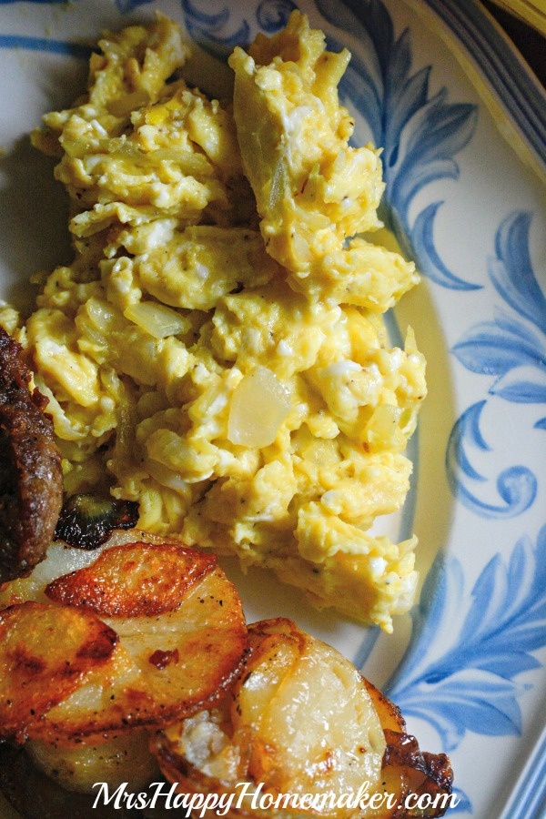I never liked scrambled eggs before trying this recipe for Grandma Lynne's Eggs & Onions. Now, I can't get enough! Bonus points - you only need 3 ingredients (not counting salt & pepper!). | MrsHappyHomemaker.com @thathousewife