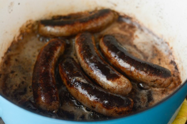sausages cooking in a pot