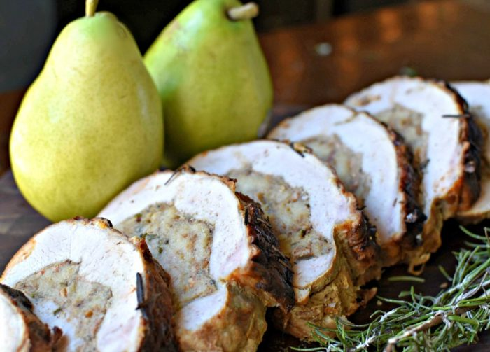 I am s0 in love with this delicious dish! Pork loin butterflied & then rolled with a sourdough stuffing complete with fresh pears, crispy bacon, & savory garlic & onion - guaranteed to make your tastebuds dance. This is one recipe that's going to be hard to beat this holiday season! | MrsHappyHomemaker.com @thathousewife