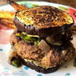 This SPICY JALAPENO BURGER with a garlic crusted eggplant bun has been the recipe to get me through my burger cravings during my Whole30 reset… and to be completely honest, I don't even miss the bun at all. Since their is no bun, obviously it's low carb, gluten & grain free. It's SO good. Like really, truly GOOD. Perfect for anyone trying to eat healthier (or doing paleo, keto, etc) while not wanting to sacrifice flavor. | MrsHappyHomemaker.com