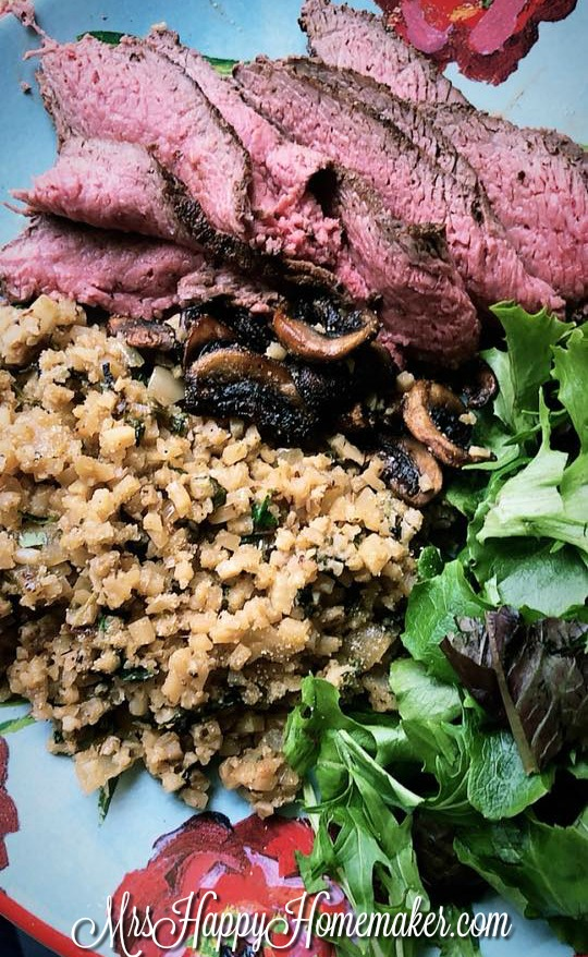 Cilantro Lime Cauliflower Rice with thinly sliced steak and salad