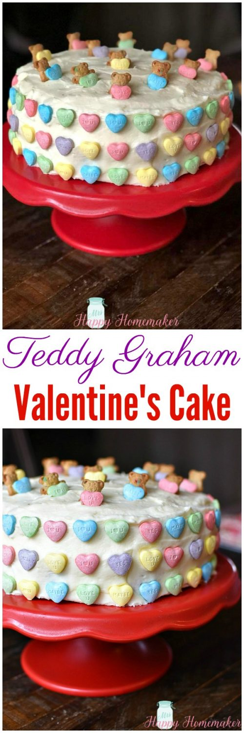 Easy Teddy Graham Valentine's Cake on a red cake stand with conversation hearts all over the cake