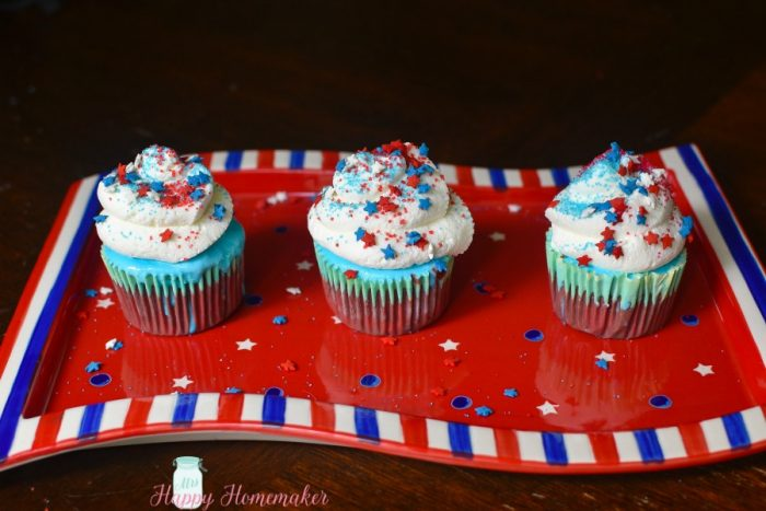 PATRIOTIC ICE CREAM CUPCAKES - layers of red velvet cake, blue vanilla ice cream, & marshmallow whipped cream make up this deliciously easy red, white & blue treat. | MrsHappyHomemaker.com @mrshappyhomemaker