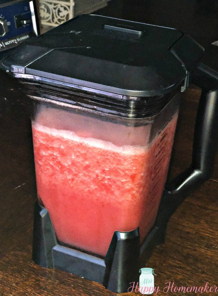 watermelon slush being blended in a blender