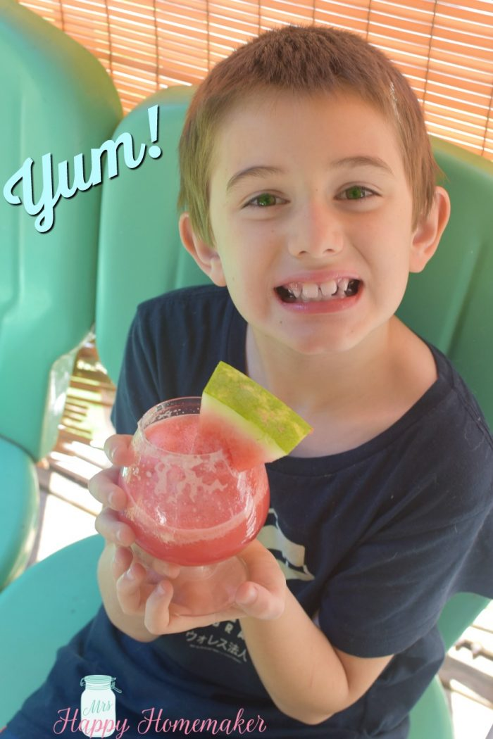 Ethan drinking a 3 Ingredient Watermelon Lemonade Slush with watermelon garnish