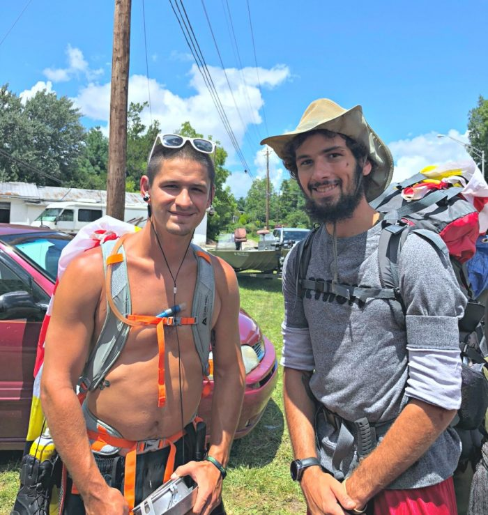 two hikers with hiking gear