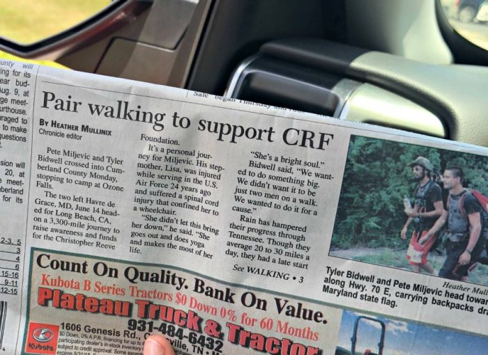 a picture of a newspaper clipping about a pair walking to support CRF