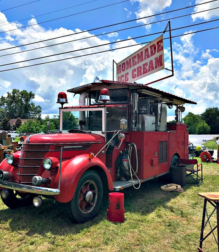 homemade ice cream being sold out of a vintage fire truck