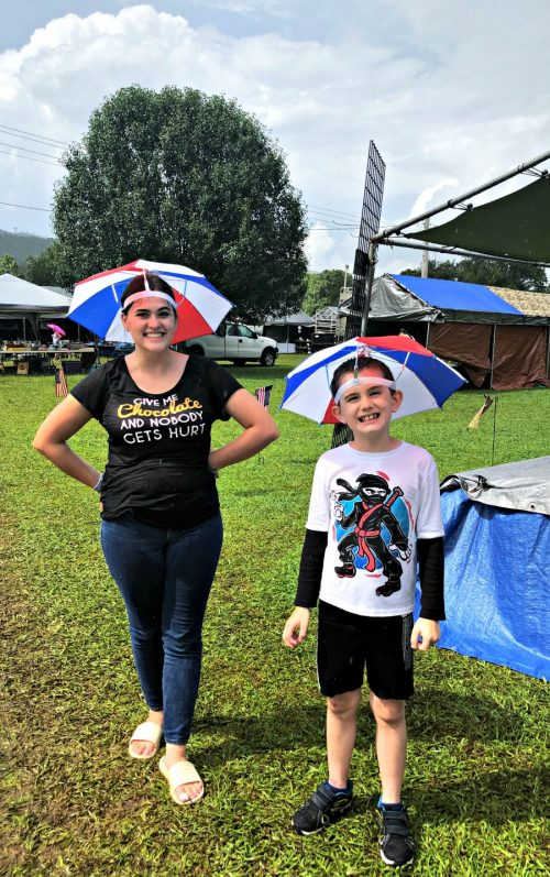 two kids wearing umbrella hats