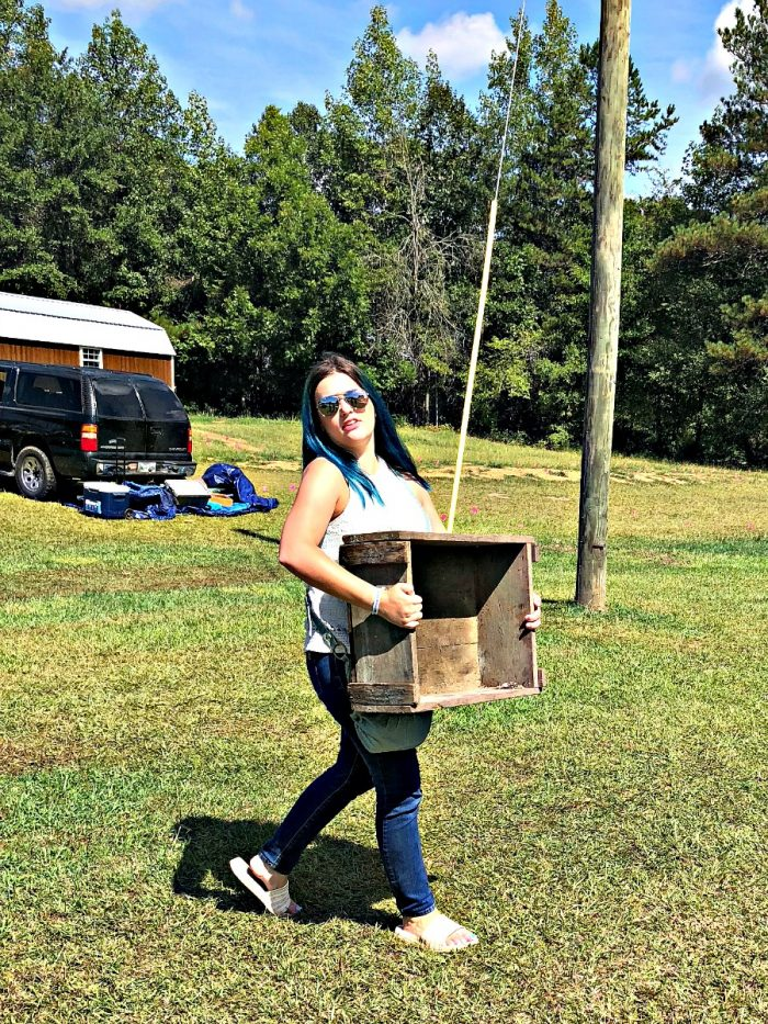 blue haired girl carrying a box