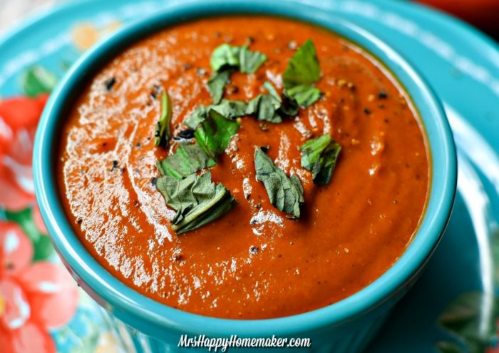 Roasted Tomato Soup with parsley garnish in a blue bowl