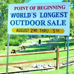 world's largest yard sale point of beginning sign