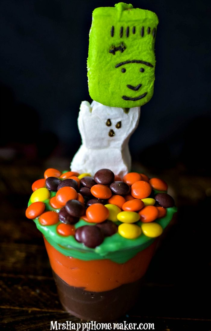 Easy Halloween Pudding Parfaits with monster peeps on a skewer