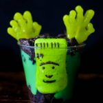 Zombie Pudding Cups with candy hands