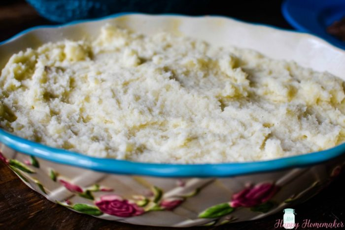 Creamy Mashed Potatoes in a pretty light blue rimmed floral dish