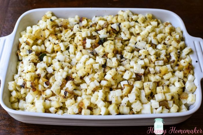 Cheesy Hash Brown Casserole being made - potatoes in the casserole dish