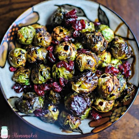 Balsamic Cranberry Roasted Brussel Sprouts - roasted to perfection & drizzled with a balsamic glaze & dried cranberries | MrsHappyHomemaker.com