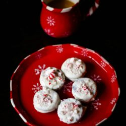 Easy Peppermint Bark Oreos with a cup of coffee