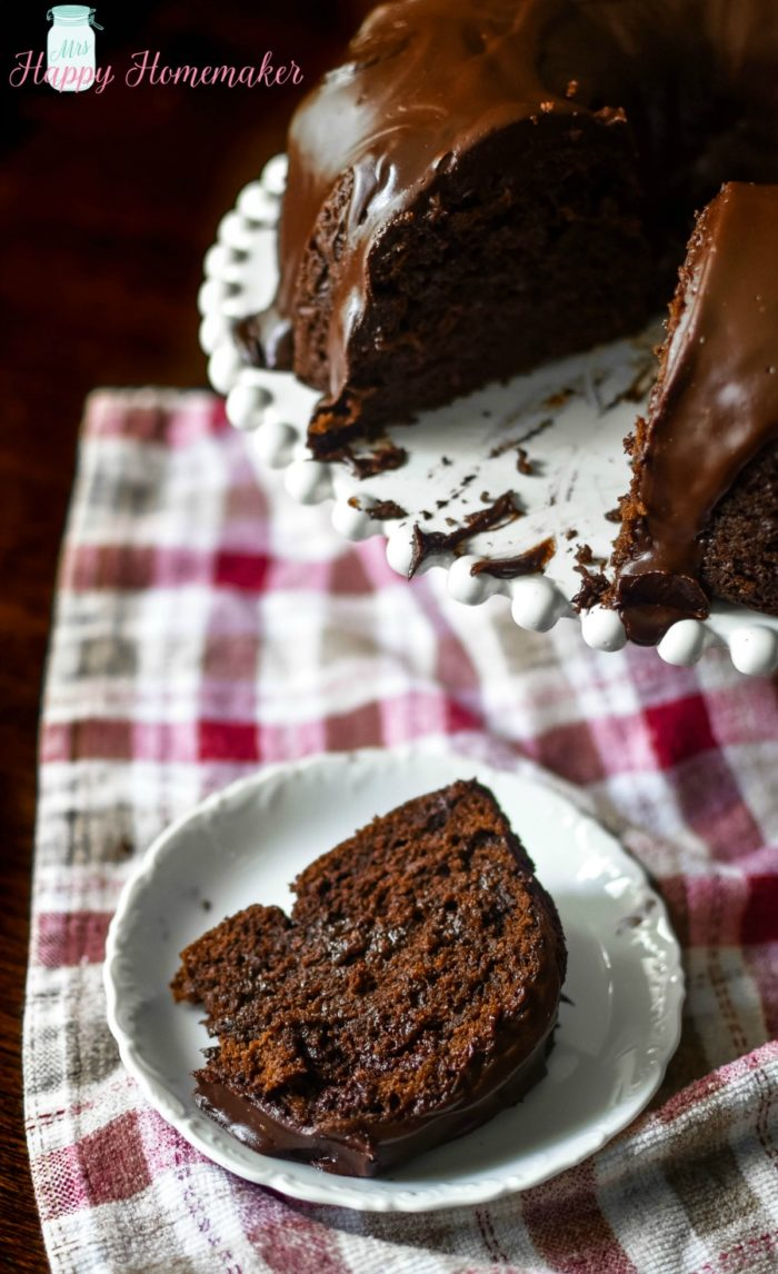 Chocolate Overboard Bundt Cake - the easiest, richest, most decadent (but still simple!) chocolate cake I have ever made... and it starts with a cake mix! Covered with chocolate ganache | MrsHappyHomemaker.com