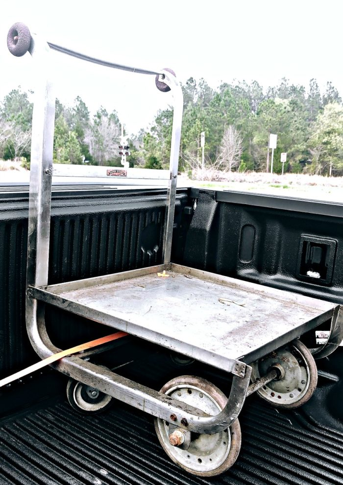 Unique wheeled Cart strapped inside of a pickup bed