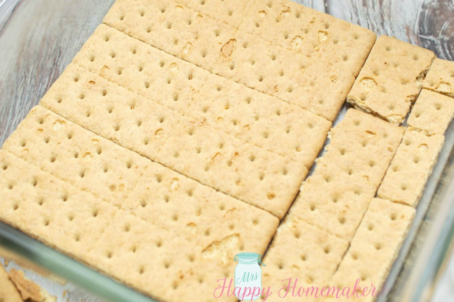 graham crackers fitted into a square casserole dish