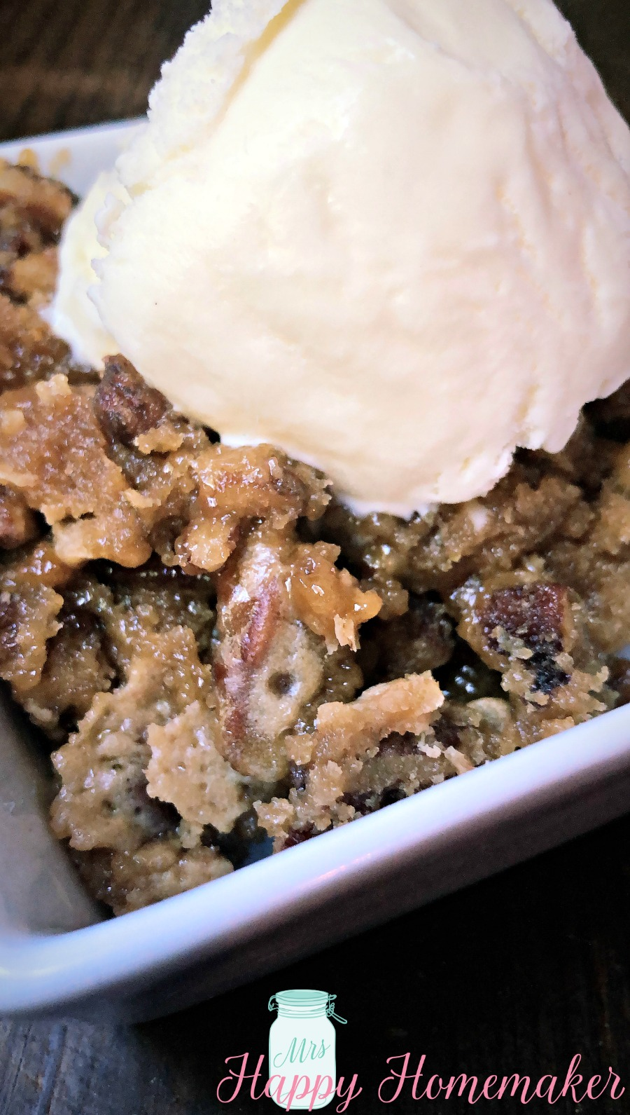 Crockpot Pecan Pie Cake with a scoop of ice cream on top