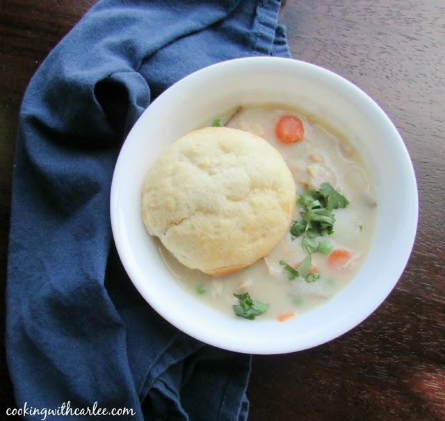 creamy chicken pot pie soup in a white bowl
