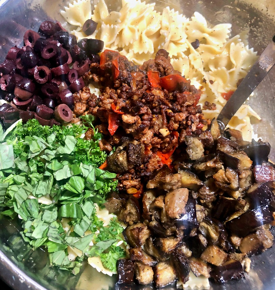 Sausage and Eggplant Greek Pasta Salad ingredients in a bowl