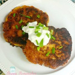 zucchini fritters topped with sour cream and green onions