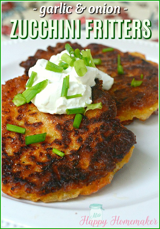 Garlic & Onion Zucchini Fritters topped with sour cream and chopped green onions