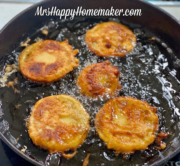 Beer battered fried green tomatoes frying in a skillet