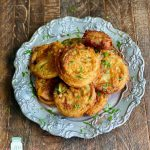 Fried green tomatoes on silver plate