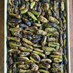 Roasted jalapeños on a baking sheet